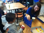 Meg Caldwell playing a game of Connect Four with one of the patients at RMH.