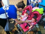Angela Garcia feeding two twin girls receiving care at Holtz Children's Hospital who are able to thanks to Ronald McDonald House.