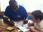 Mike Hill working on some coloring with one of the patients from RMH.