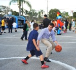 David Samson showing basketball skills at graduation party